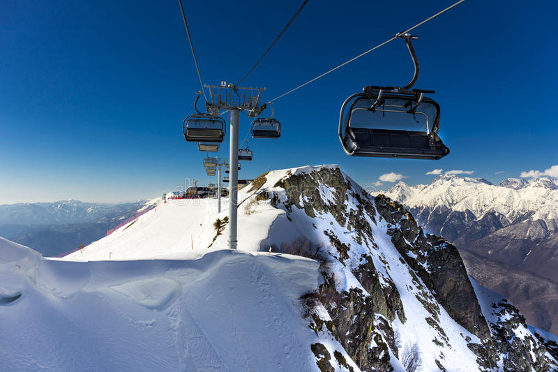 Scenery top view on winter mountains from ski resort Gorky Gorod. Scenery top view on winter mountains with ski elevators from ski resort Gorky Gorod royalty free stock photo