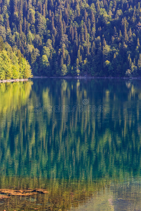 Scenery view of colorful mountain lake. With crystal water and beautful reflections royalty free stock image