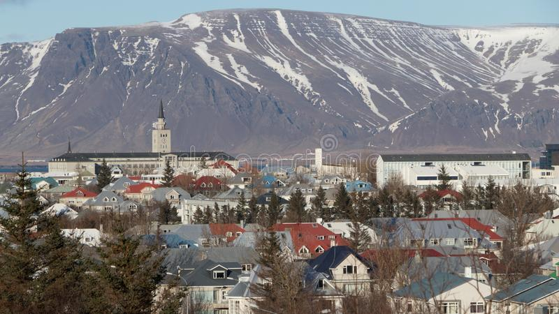 Scenery view of Iceland cityscape.Reykjavik Landscape the capital city of Iceland in winter with snowcapped mountain in background.  stock photos