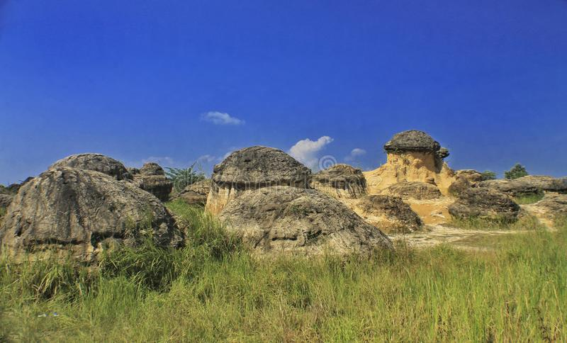 Scenery view of mushroom hill. Nature, landscape, blue, sky, hills, mountain, grass, rock, stone royalty free stock image