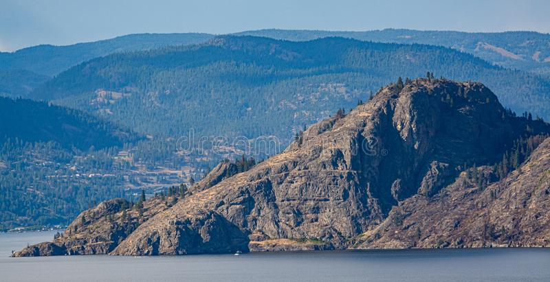 Scenery view of rocky mountain slope over the lake in British Columbia. Scenery view of rocky mountain slope over the lake in British Columbia stock photos
