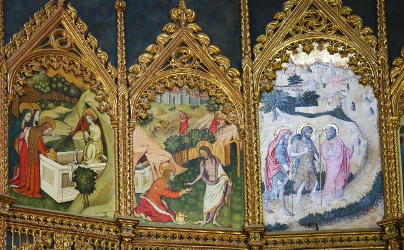 Scenes of the Gospel in Salamanca Old Cathedral. Retable (1430-1450) of the Old Cathedral or Catedral Vieja of Salamanca, Spain, depicting a Saint and Jesus at royalty free stock photos