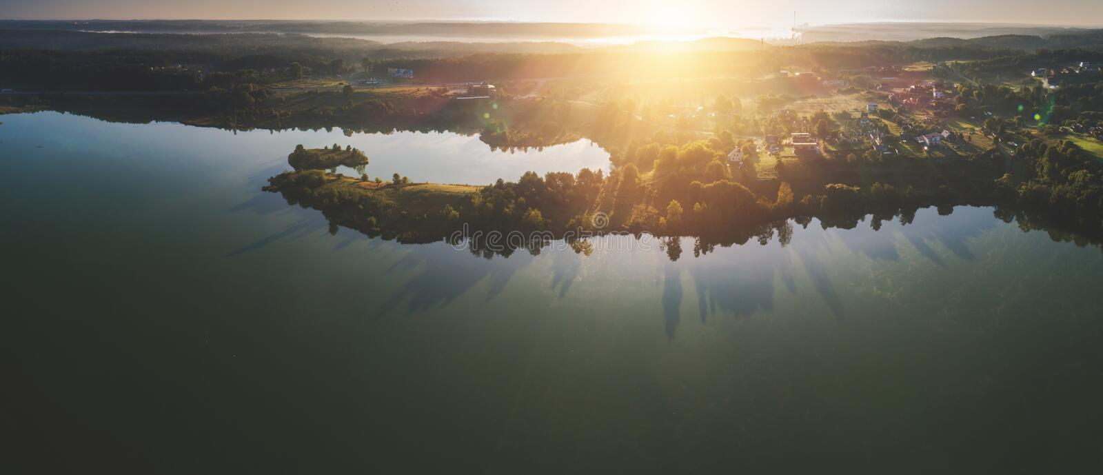 Scenic aerial landscape of lake at sunrise stock images