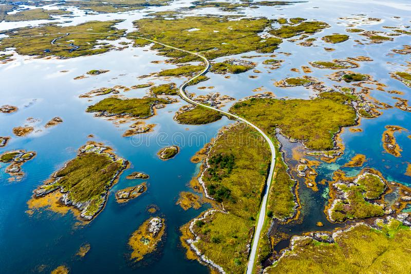 Scenic aerial view of beautiful road with bridge on the island Smola, Norway.  royalty free stock photos