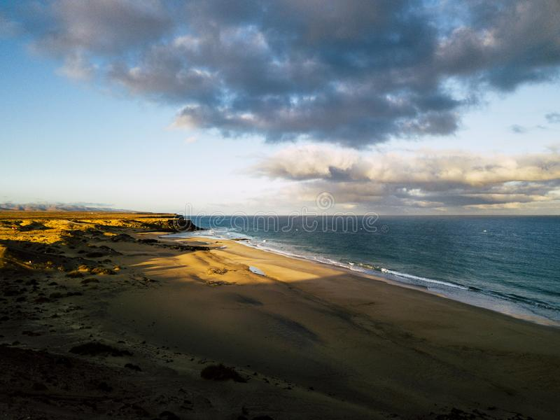 Scenic aerial view of bech and ocean water in the sunset -  concept of tourism and travel vacation activity - beautiful scenic. Place landscape with sea and stock photo