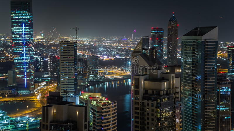 Scenic aerial view of a big modern city at night timelapse. Business bay, Dubai, United Arab Emirates. Scenic aerial view of a big modern city at night stock video footage
