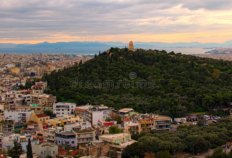 Scenic aerial view over the city of Athens against cloudy sky. Famous touristic place and travel destination in Europe. Greece.  royalty free stock images