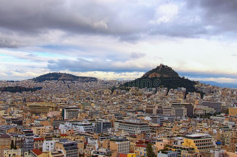 Scenic aerial view over the city of Athens against cloudy sky. Famous touristic place and travel destination in Europe. Greece.  stock images
