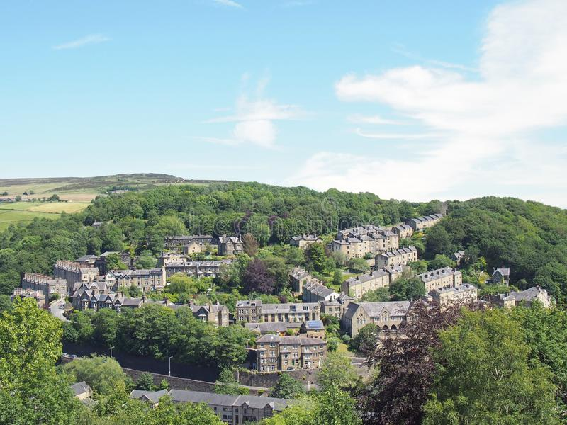 A scenic aerial view of the town of hebden bridge in west yorkshire with streets of stone houses and roads between woodland trees royalty free stock images