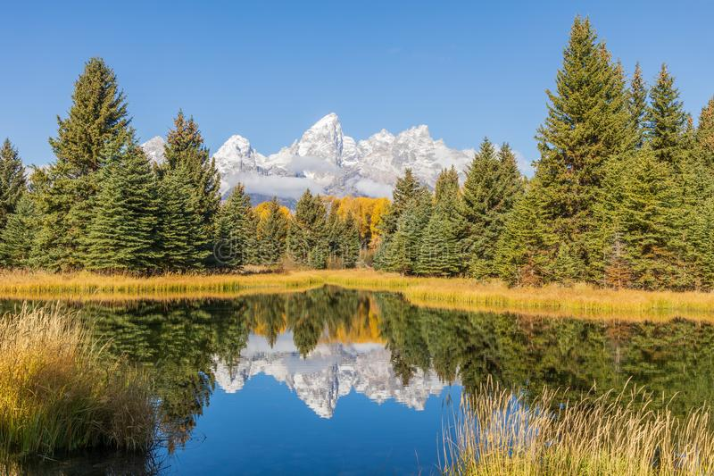 Scenic Autumn Reflection Landscape in the Tetons royalty free stock images