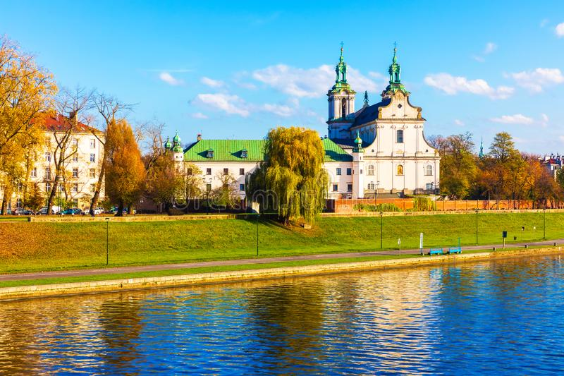 Krakow, Poland. Scenic autumn view of ancient Christian Church at the Vistula river embankment in the Old Town of Krakow, Poland royalty free stock image