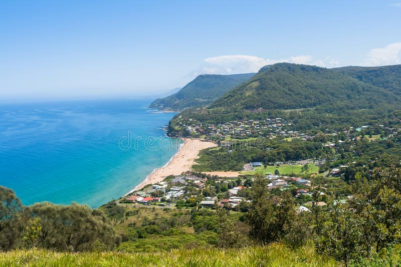 Blue Ocean Waters Beach Countryside Landscape. Scenic beach coves with clear blue waters ocean beautiful countryside homes houses rural hills landscape south of stock image