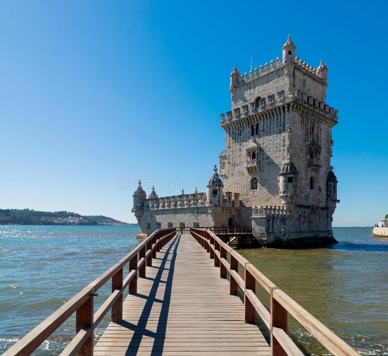 Scenic Belem Tower and wooden bridge miroring with low tides on Tagus River. Torre de Belem is Unesco Heritage and icon of Lisbon royalty free stock photo