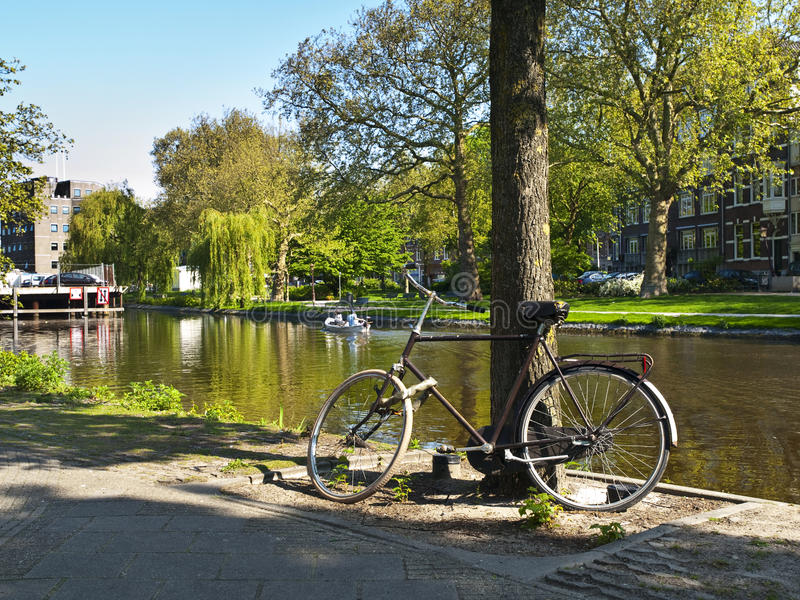 Scenic Bycicle In An Amsterdam Canal Stock Photography