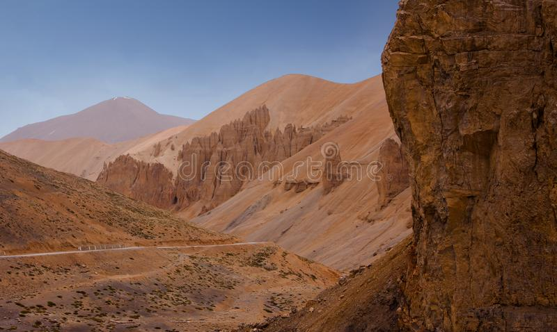 Scenic canyon landscape with weird rocks, blue sky and empty winding highway. stock photography