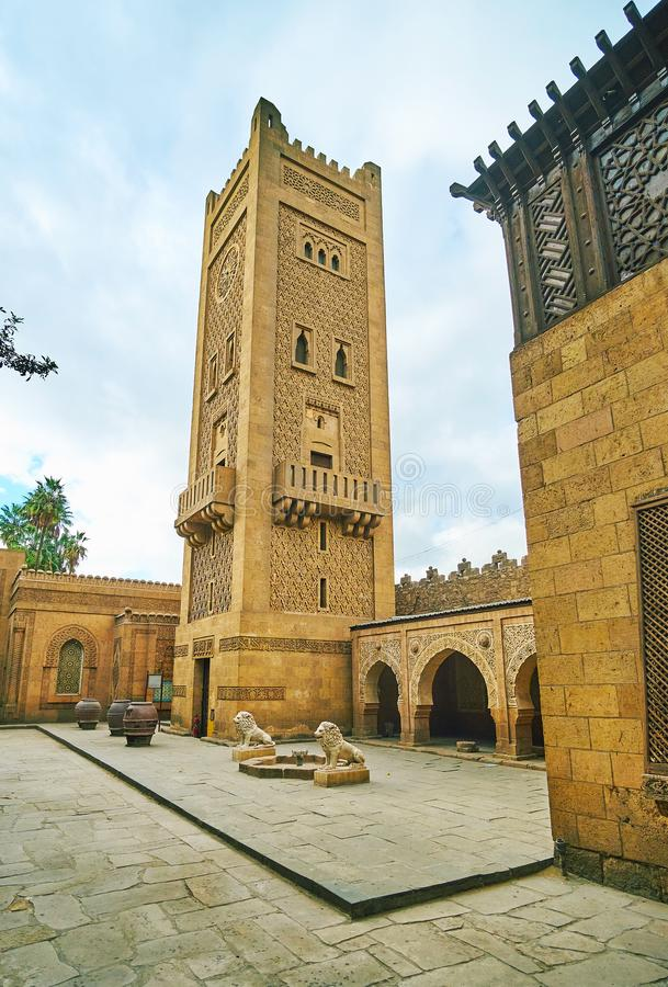 The minaret with clock tower, Manial Palace, Cairo, Egypt. The scenic carved minaret of Manial Palace mosque also serves as the clock tower, Cairo, Egypt stock image