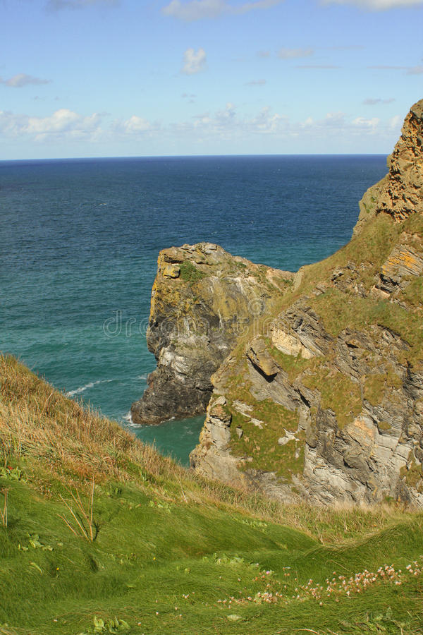 Scenic clifftop view. Blue sky and turquoise sea from a clifftop view of dangerous rocks royalty free stock photography