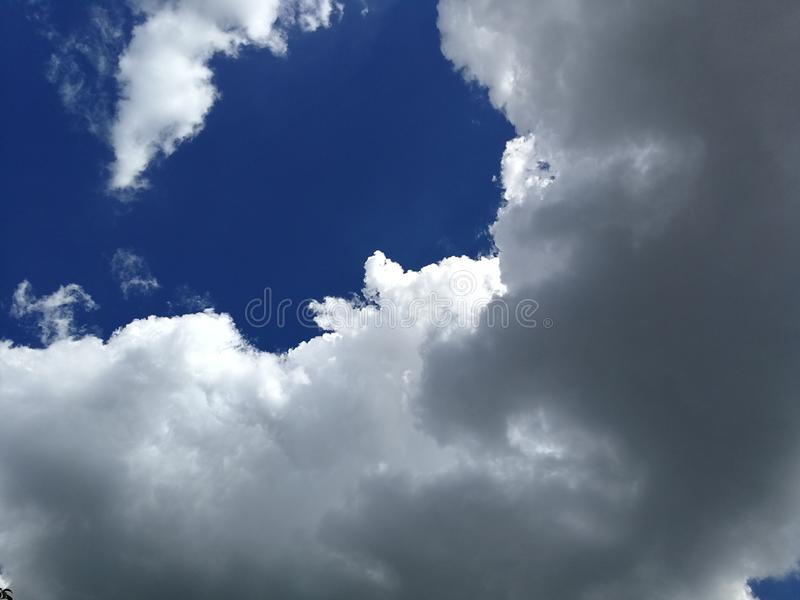 Scenic clouds and blue sky in rainy season, the rain is coming. Dramatic sky in rainy season stock photography