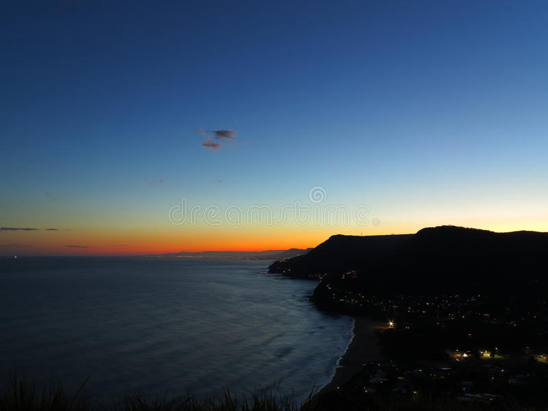 Scenic coastline silhouetted by nightfall view from lookout royalty free stock photography