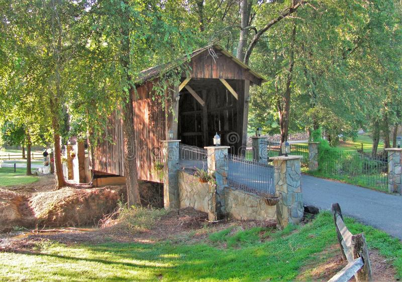 Covered Bridge at Cody Creek. Scenic covered bridge is partially shaded from the afternoon sun. North Carolina stock image