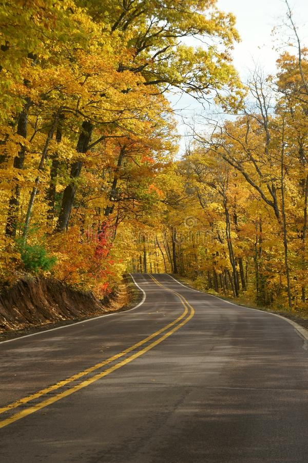 Scenic Drive through a fall forest. This scenic Drive is a section of highway 41, just south of Copper Harbor Michigan. It is a beautiful stretch of winding road royalty free stock images