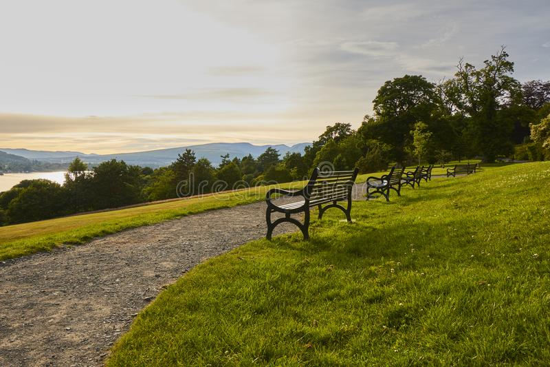Scenic evening view of Balloch Castle Country Park with historic benches and Loch Lomond in Scotland, United Kingdom. Scenic evening view of Balloch Castle royalty free stock photos