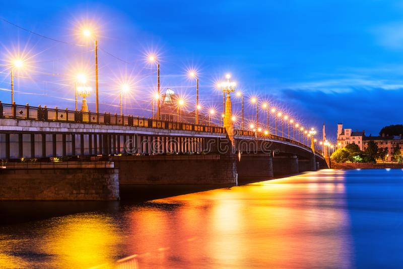 Bridge over Daugava River in Riga, Latvia. Scenic evening view of the illuminated bridge over Daugava River in Riga, Latvia stock image