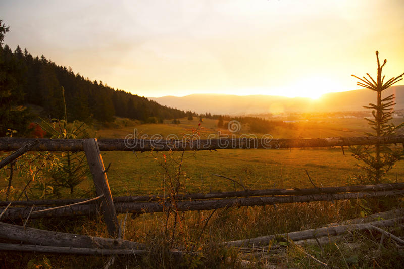 Scenic fall sunset over meadow. Countryside beautiful sunset royalty free stock image