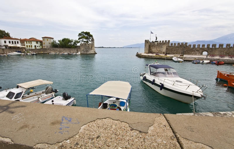 Scenic fishing port of Nafpaktos in Greece. Scenic fishing port of Nafpaktos city in Greece stock photos