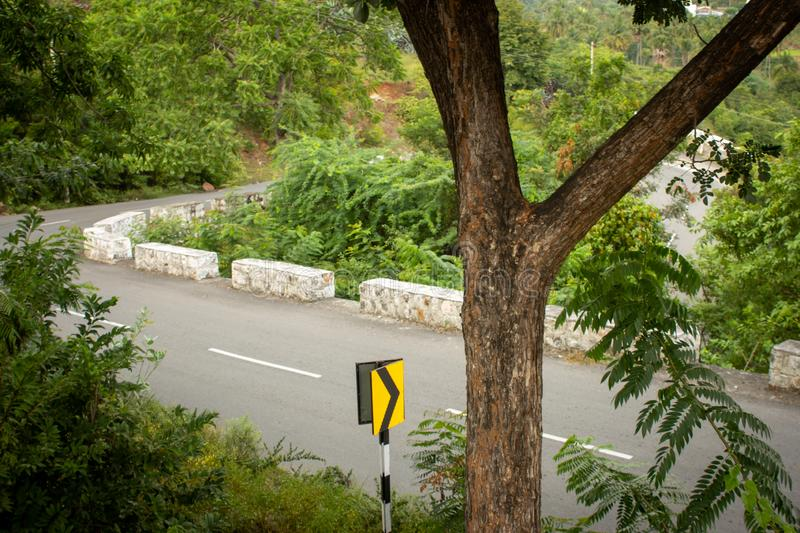 Scenic ghat road along the mountain range of Salem, Tamil Nadu , India. Beautiful road going through the hills in eastern ghats, Salem, India stock image