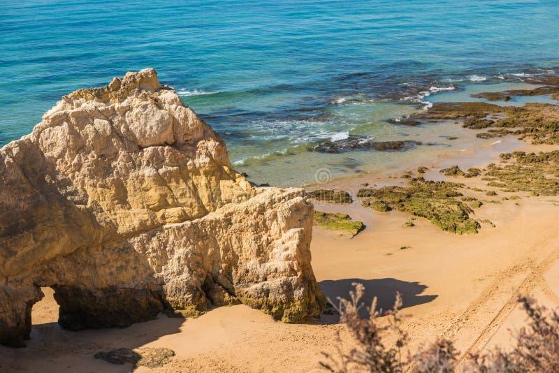 Scenic golden cliffs near Alvor, Portimao, Algarve royalty free stock photo