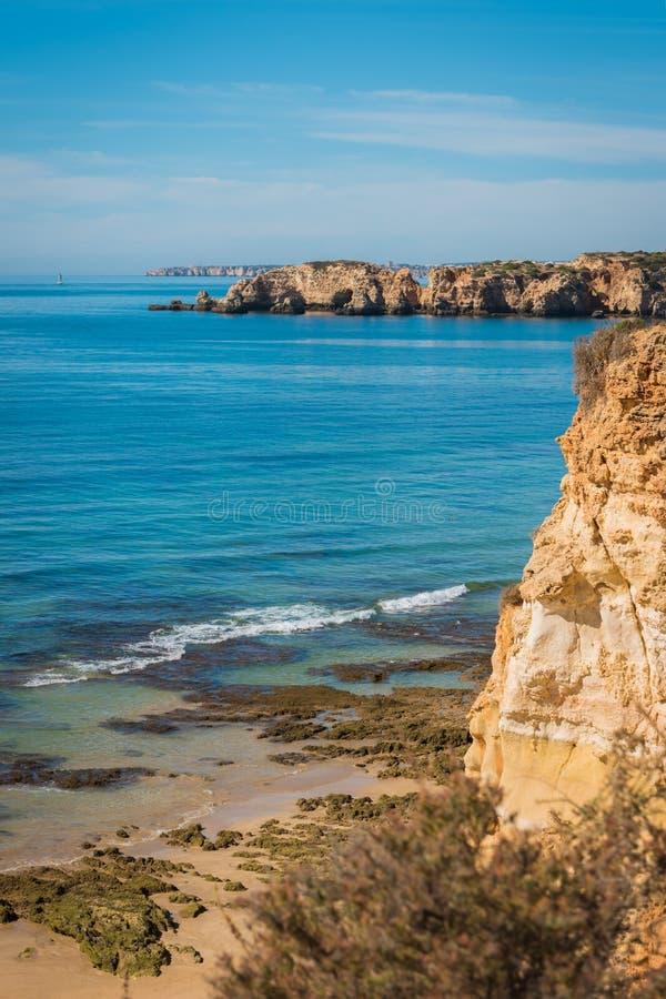 Scenic golden cliffs near Alvor, Portimao, Algarve royalty free stock image