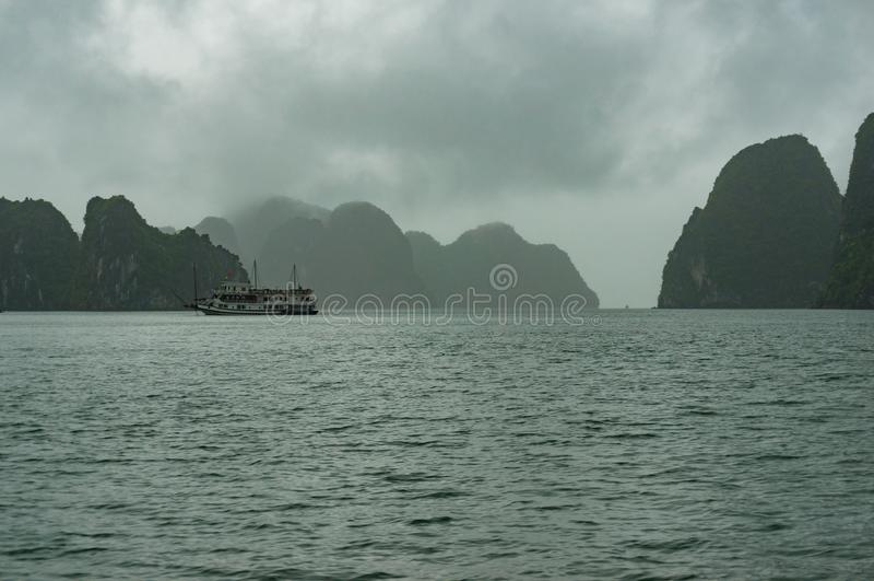 Scenic karst islands of Halong Bay on mist royalty free stock photos