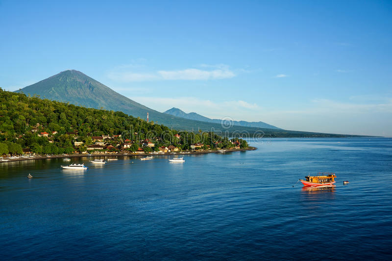 Scenic lagoon with boats in small village Amed stock photo
