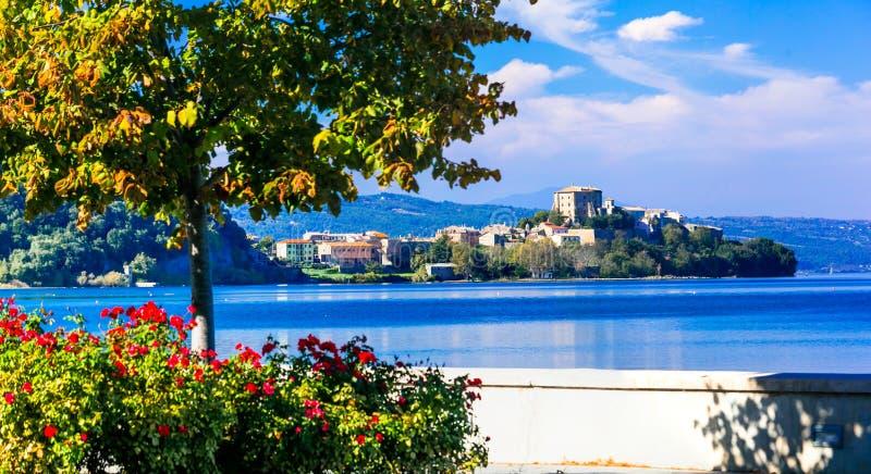 Scenic lake Bolsena lago di Bolsena with view of medieval borg. Beautiful Capodimonte village ,panoramic view with Bolsena lake,Viterbo province,Lazio,Italy stock photography