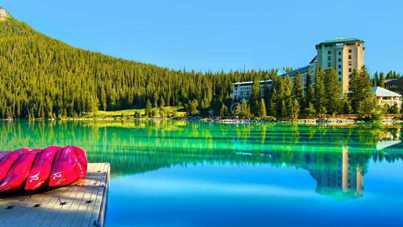 Scenic Lake Louise, Banff National Park, Canada. Scenic view of Lake Louise with boats in the morning light. Banff National Park, Alberta, Canada stock image