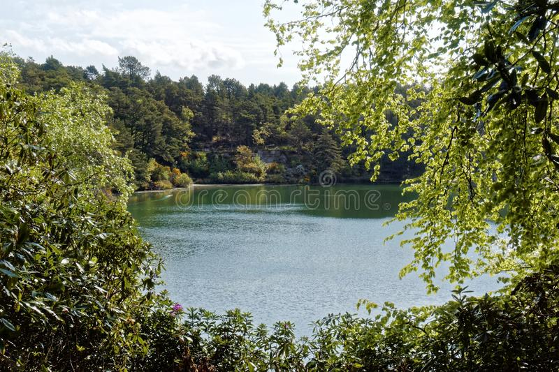 Scenic Lake and Woodlands at the Blue Pool, Dorset, England royalty free stock photography