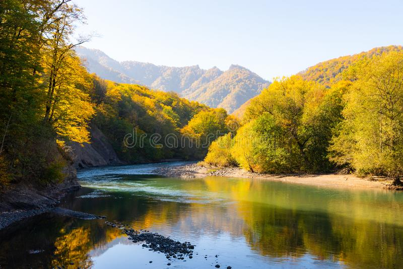 Scenic landscape with beautiful mountain river. Autumn in mountain forest royalty free stock photo