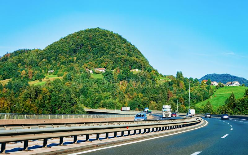 Scenic landscape and cars in road in Slovenia Julian Alps royalty free stock images
