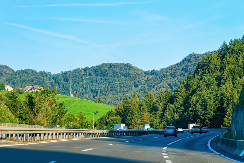 Scenic landscape and cars on road in Slovenia Julian Alps royalty free stock photo
