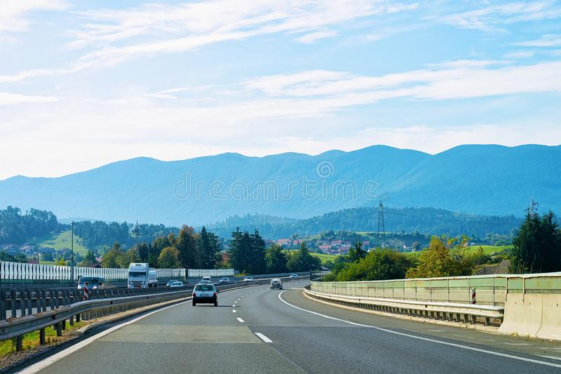 Scenic landscape with cars at road in Slovenia Julian Alps royalty free stock photos