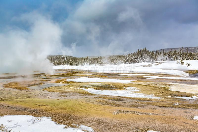 Scenic landscape of geothermal pools and mist in Yellowstone in stock photography