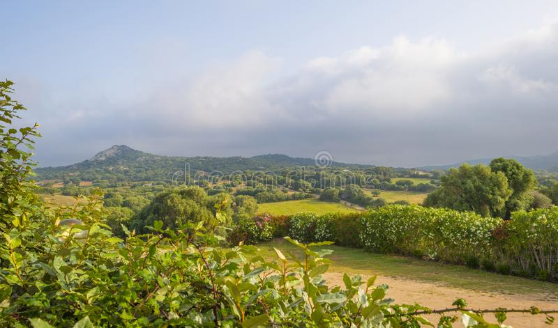 Scenic landscape of green hills and rocky mountains of the island of Sardinia royalty free stock photography