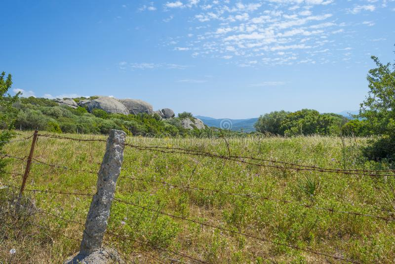 Scenic landscape of green hills and rocky mountains of the island of Sardinia stock photography