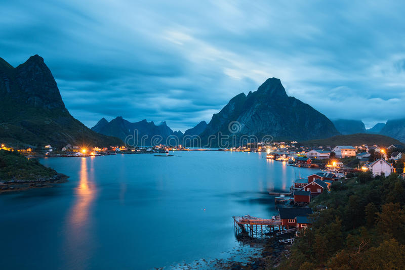 Scenic landscape on Lofoten islands with typical red fishing hut near mountains stock images