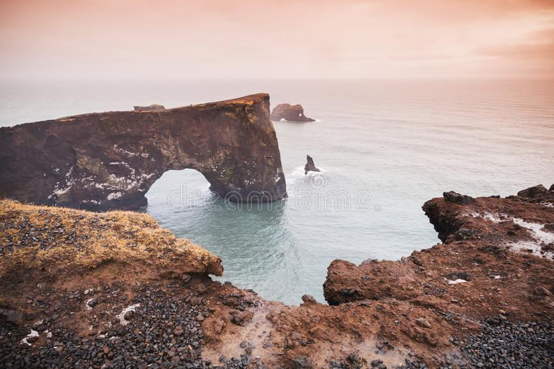 Icelandic llandscape with natural stone arch royalty free stock photography