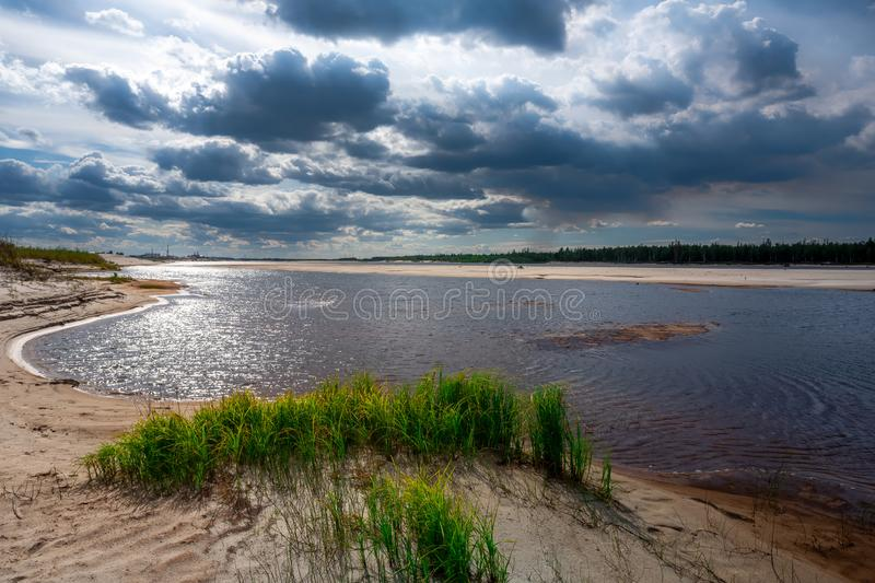 Scenic landscape of nature in Siberia, the Yamal Peninsula. The bank of the river Pur in the rays of the evening sun stock photo