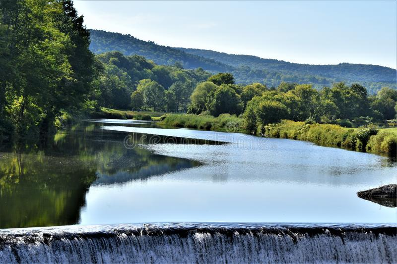 Ottauquechee River and dam, Quechee Village, Town of Hartford, Windsor County, Vermont, United States. Scenic landscape of Ottauquechee River and dam, villlage stock photo