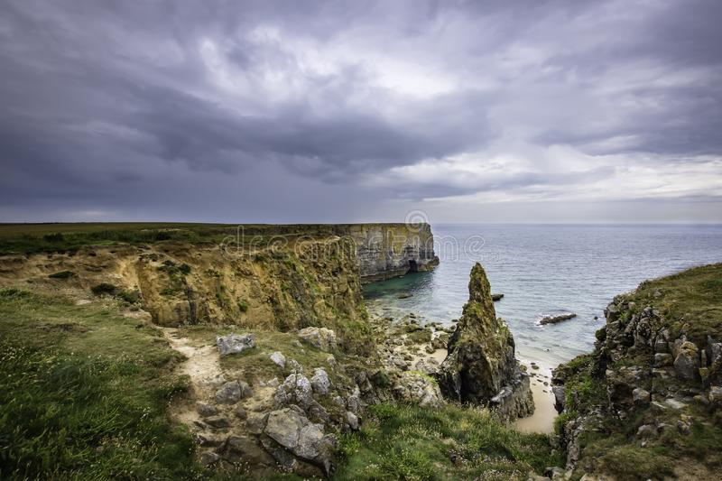 Scenic landscape of Pembrokeshire coast, Uk.Rain clouds building. Beautiful scenery of dramatic Pembrokeshire coastline,South Wales, Uk in summer.Scenic stock photography