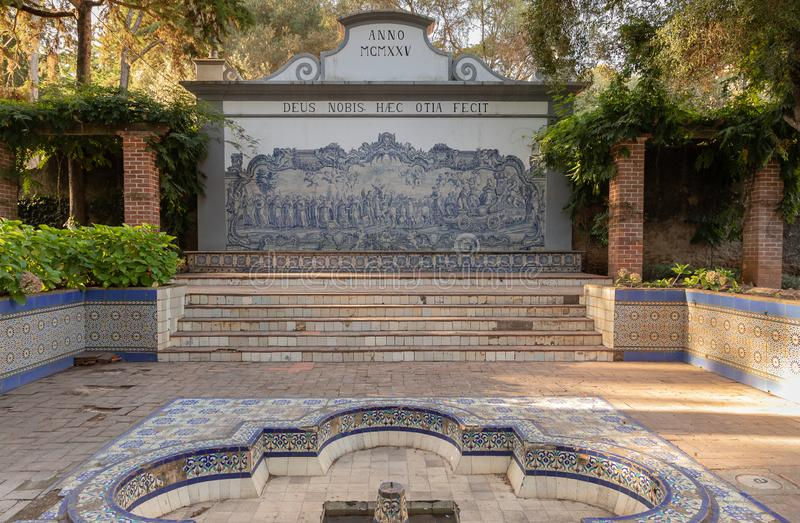 Scenic landscape with tiled fountain at the Parque Marechal Carmona in Cascais, Portugal. Scenic landscape with tiled fountain in warm afternoon sunlight at the stock images